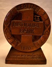 1st National Bank Seattle 1870 Bank Bronze Metal Colored no key over 4 i... - $12.86