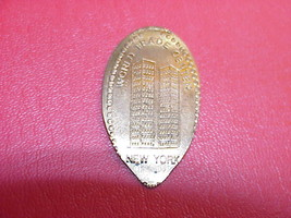 WORLD TRADE CENTER  BY G.W.E.   ON OLDER ELONGATED ALL COPPER  CENT B16#131 - $2.92