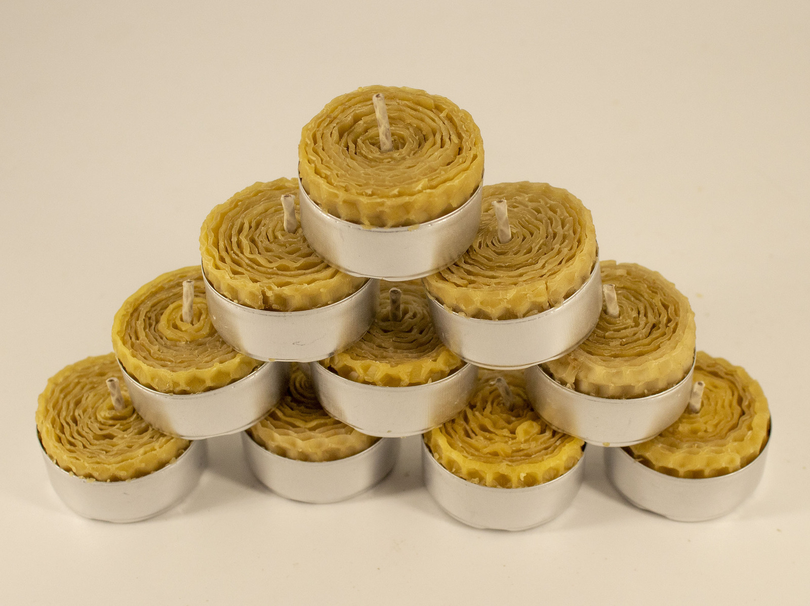 Primary image for 10 pcs. 100% pure beeswax tealight 3,5 x 2 cm