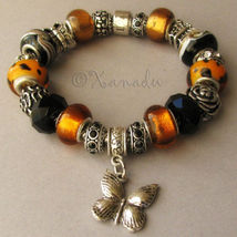 The Great Monarch Butterfly Migration Black Amber European Style Charm Bracelet - $70.00