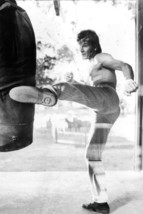 Patrick Swayze bare chested kicks punchbag cool pose Roadhouse 18x24 Poster - $23.99