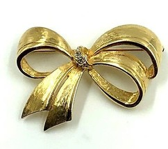 Avon Brooch Pin Shiny Ribbon Shaped Rhinestones Vintage 2.25 by 1.5 Inches - $11.88