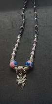 Eye-Catching Silver Fairy Charm on stylish beaded necklace pink & black - $15.99