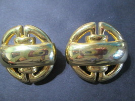 1980s Clip On Bold Earrings Shiny Gold Tone Designer Styling Carved Metal - $17.00