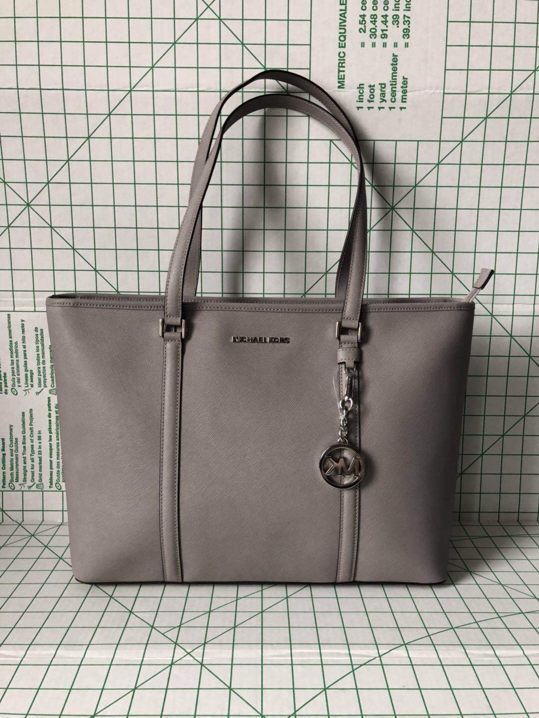 d01ad80a7b26 57. 57. Previous. Michael Kors Sady Large Multifunction Top Zip Tote Pearl  Grey Saffiano Leather B