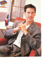 Keanu Reeves Justin Whailin teen magazine pinup clipping sitting in a red chair
