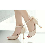 92H004 Lady's Extra large 16 cm heel booties, size 9.5-11, beige - $52.80