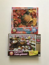 Lot Of 2 Puzzles Puzzlebug Red Robyn Bird 100 Piece Cupcake Candy Madnes... - $13.18