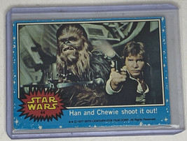 Star Wars 1977 Trading Card #44 Han and Chewie shoot it out!  - $39.59