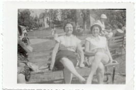 SNAPSHOT OF 2 WOMEN ON A PARK BENCH AMONGST A CROWD ONE IS WEARING RETRO... - $5.99