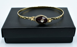 Avon Birthstone Gold tone Wire Bracelet with January Garnet Colored Stone - $7.19