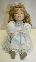 Vintage Collectors Choice Dandee Sitting Musical Animated Porcelain Doll - $19.79