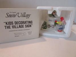 Dept 56 51349 Kids Decorating The Village Sign Figurine Snow Village L126 - $12.72