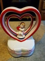 1984 signed by geo z. lefton 04393 musical and rotating cupid - $48.15