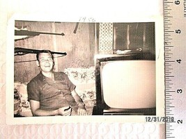 Vintage Black & White Photo Of A Smiling Man Sitting On Couch TV Rifles ... - $15.83