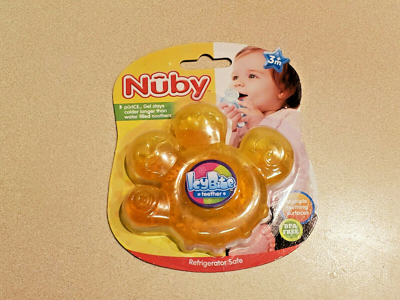 Primary image for NUBY TEETHER COLOR YELLOW PAW ICY BITE GEL-COLD FILLED TEETHER #621 (NEW)