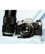 Olympus OM10 35mm SLR Camera c/w 50mm + 75-150mm Zuiko Lenses + Man Ad  ... - $125.00
