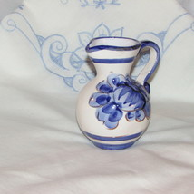 "SMALL HAND PAINTED POTTERY PITCHER 4"" TALL WHITE & LARGE BLUE FLOWER FOL... - $5.47"