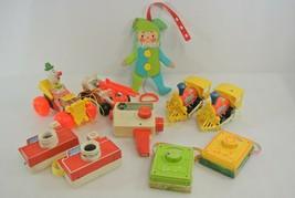 Fisher-Price Lot of 10 Vintage Toys Radios Movie Camera Jumping Jack Tra... - $62.88