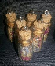 All is well spell bottle pendants charged sealed - $15.00