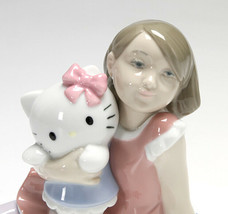 Nao By Lladro 02001664 Playing With Hello Kitty Porcelain Figurine New - $158.40