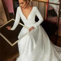 Booma Lace Long Sleeve V-neck Backless Satin Wedding Gown Plus Sizes image 3