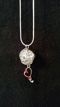 Cystal clear cracked glass marble pendant with dazzling red heart charm - $11.95