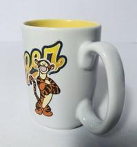 Tigger Disney Store Winnie the Pooh Parks Coffee Mug Yellow Script Cup E... - $17.81