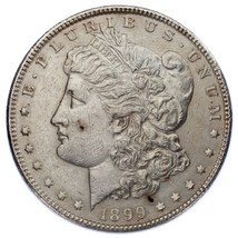 1899 $1 Silver Morgan Dollar VF Condition, XF in Wear, Some Debris on RX - $133.64