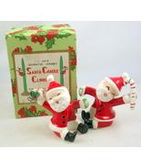 Napco Santa ceramic candle climbers pair 3BX2746/C Japan candy cane holly  - $30.00