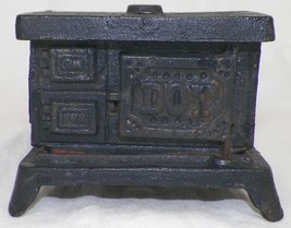 VINTAGE CAST IRON DOT STOVE BANK MINIATURE COOK WITH CASH TOY DOLLHOUSE ... - $13.99