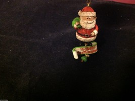 Jim Shore ornament with Santa and HO HO HO from Rudolph cartoon feature
