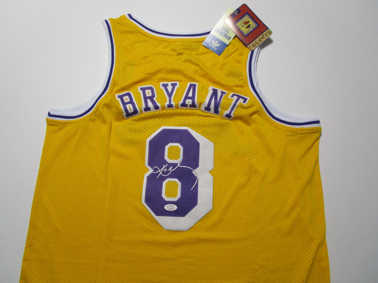 KOBE BRYANT / NBA HALL OF FAME / AUTOGRAPHED L.A. LAKERS THROWBACK JERSEY / COA