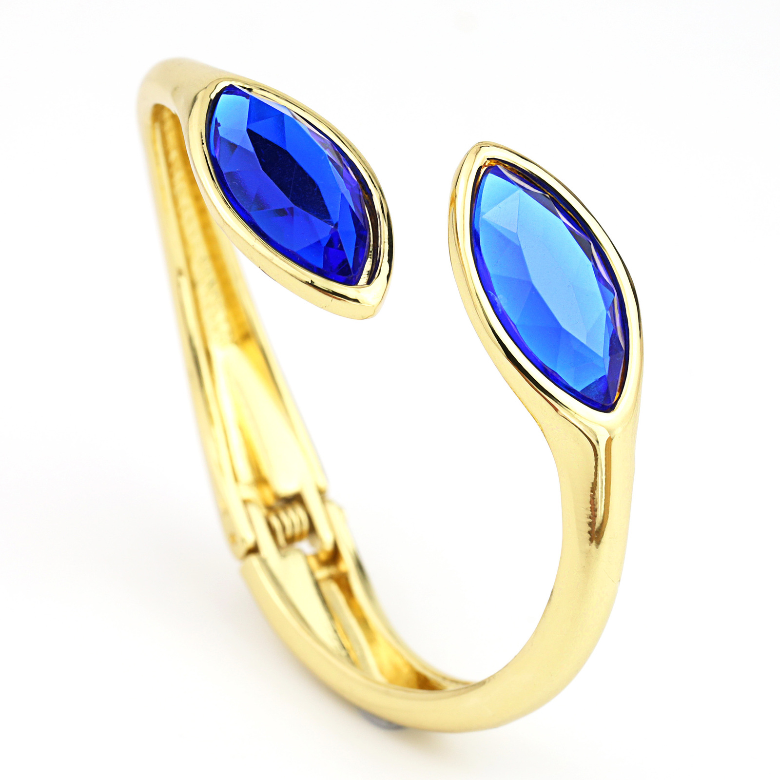 UE-Stunning Designer Gold Tone Bangle Bracelet With Cobalt Blue Faux Sapphires