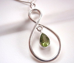Faceted Peridot Necklace 925 Sterling Silver Infinity Hoop is Everlasting Love - $27.71
