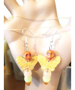 glow in the dark earrings sugar skull earrings butterfly dangles orange ... - $6.99