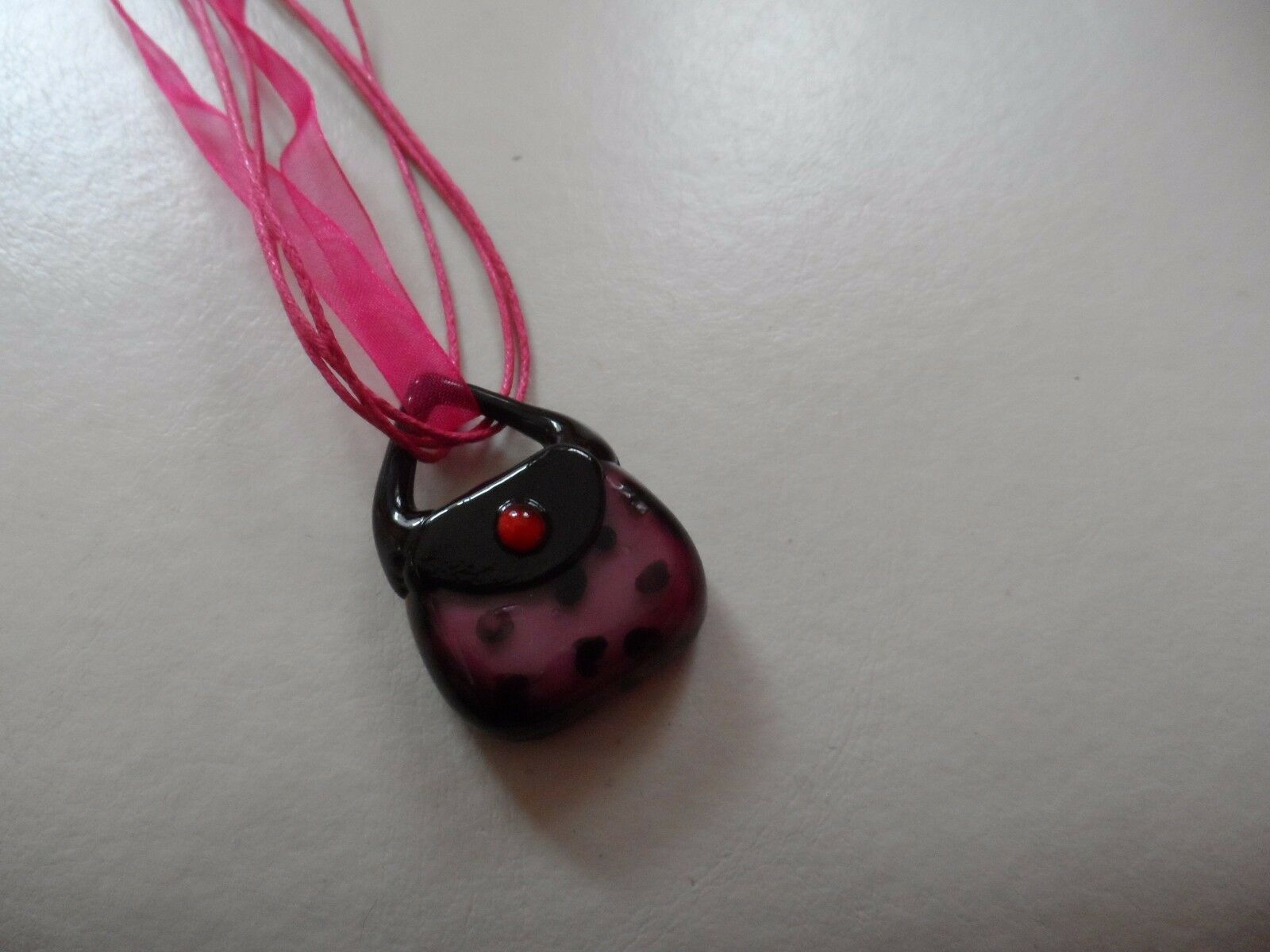 Eggplant and black Murano glass purse handbag pendant on a ribbon necklace