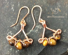 Handmade tiger eye earrings: criss cross copper wire wrapped fans - $30.00