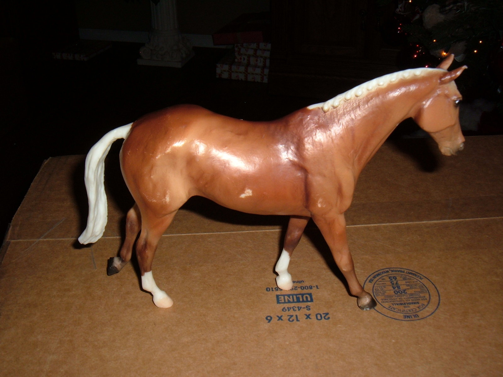"Primary image for Breyer Collectible 11""x 10"" written on belly cuepid?"