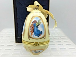 Mr Christmas 2006 Musical Egg Ornament Angel Carrying Child by Valerie Parr Hill - $19.39