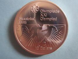 1976 MONTREAL XXI OLYMPIAD 10 DOLLAR SILVER COIN.--RB35-2 - $26.45