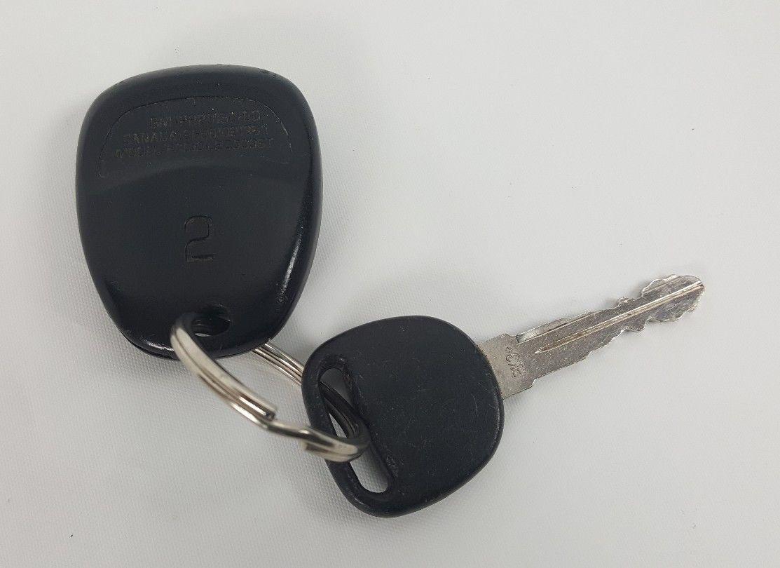 Cadillac OEM Key and Fob Used GM 12223130-50
