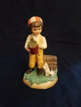 Porcelain Boy with beanie, holding potted plant with his dog - $3.47