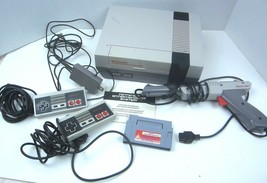 Vintage Nintendo Entertainment System NES With Controllers, Gun & Cleaning Cart - $69.19