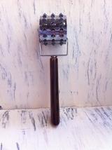 Vintage Rolling Meat Tenderizer With A Brown Marbled Bakelite Handle - $9.98