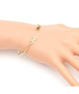 UE- Stylish Gold Tone Designer Bangle Bracelet With Contemporary Infinit... - $12.99