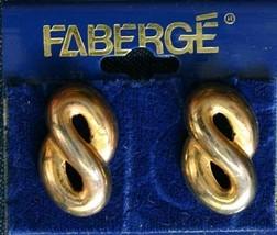 "Faberge' Vintage Gold-tone Swirl Pierced Earrings on the original card 7/8"" - $12.30"