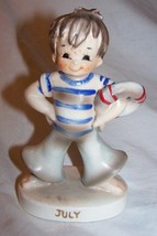 Adorable July Sailor Boy Figurine w/ring safety tube-4  1/2 inches tall - $7.50