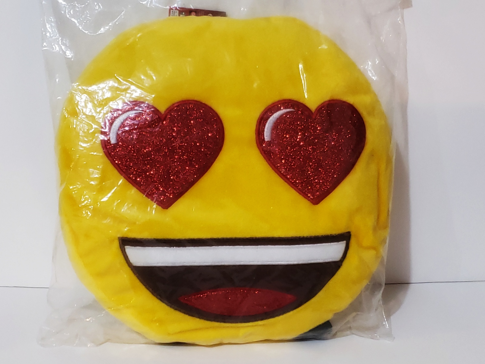 Primary image for New, Official Emoji Big Smile Heart Glitter Eyes Plush Backpack