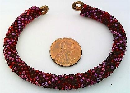 Red colors bead crochet on copper bracelet